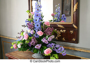 flower arrangement by mirror. decorative bouquet of bloom