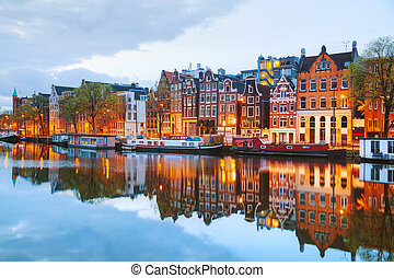 Night city view of Amsterdam, the Netherlands with Amstel...