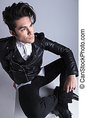 Angle view of a fashion man looking away