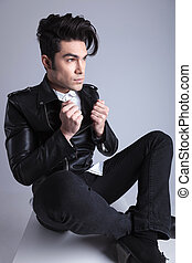 Handsome young fashion man sitting