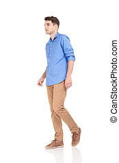 fashion man walking on isolated background.