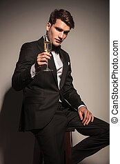 business man offering you a glass of champagne - Handsome...