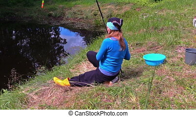 woman fishing rod cat - woman throw rod in the pond, fishing...