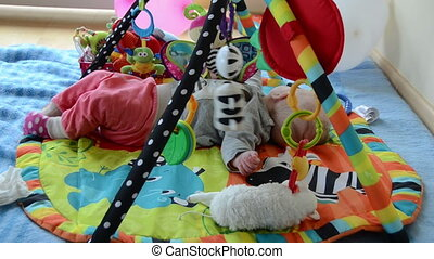 newborn on colorful mat - Newborn cute baby girl play...