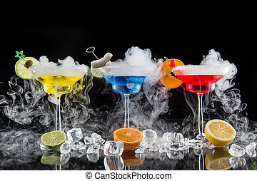 Cocktail with ice vapor on bar desk, close-up