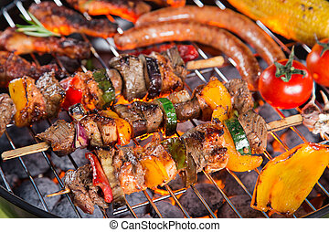 Delicious meats on garden grill, barbecue time