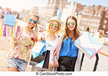 Group of friends shopping in the city