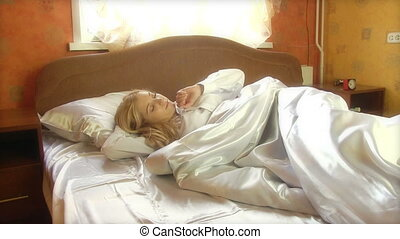 Beauty Woman Waking Up - Young beauty woman waking up in the...