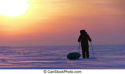 One Man In The Snow Desert - One man go to sunset on snow...