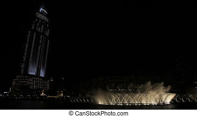 night fountain Burj Khalifa - Dubai is a city and emirate in...