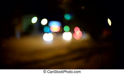 Evening traffic. The city and car lights. C-mount lens...