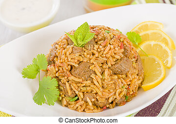 Mutton Byriani - Lamb and rice cooked with spices. Served...