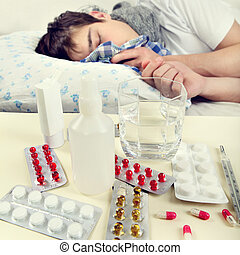 Sick Young Man - Toned Photo of Sick Young Man on the Bed....
