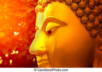Face of gold Buddha.