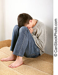 Sad Teenager on Sofa - Sad Teenager on the Sofa hide the...