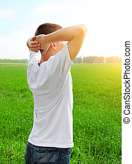 Young Man in the Field - Happy Young Man at the Summer Field