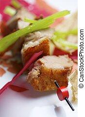 Pork jowls - Closeup of a skewer of pork jowls