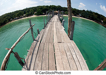 Traditional wooden bridge on the beach. - They're pieces of...