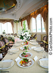 Elegant tables and chairs set up for a wedding banquet