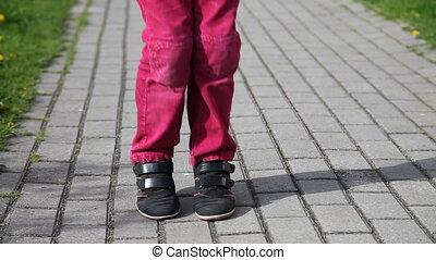 feet of little girl jumping rope - feet of little girl in...