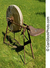 Old grindstone wheel - An old grindstone wheel with the...