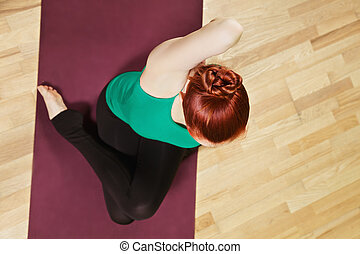 Above view yoga - Above view at yoga exercising redhead...