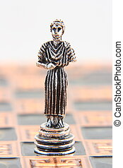 Antic chess bishop on chessboard