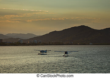 Float Planes in Harbor City of Cairns Background - Two Float...