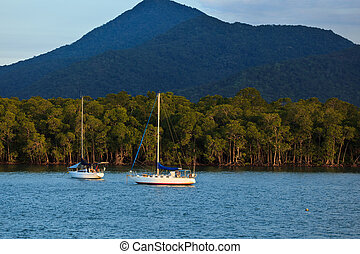 Sailboats at Sunrise in Cairns Harbor Australia - Two...