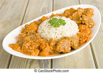 Caribbean Curry - Lamb and sweet potato peanut stew served...