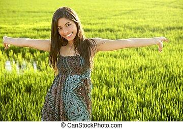 Beautiful brunette indian woman in green rice fields -...