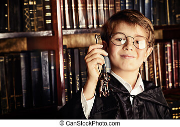 library key - Emotional boy stands with a bunch of old keys...