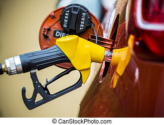 Hand refilling the car with fuel - Hand refilling the car...