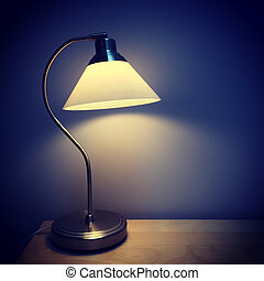 Table lamp in a dark room