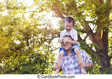 Happy father and son - Happy father with his son spending...