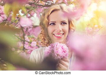 Beautiful woman in spring garden - Young beautiful woman in...