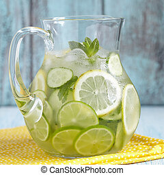 Fruit water in glass pitcher - Fruit water with lemon, lime,...