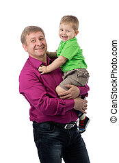Portrait of a father and three year old son in the studio.