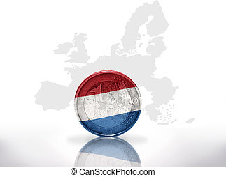 euro coin with dutch flag on the european union map...