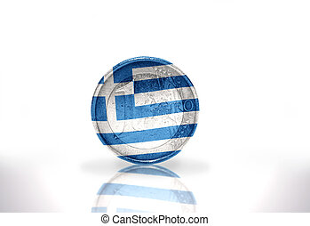 euro coin with greek flag on the white background