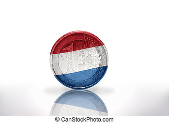 euro coin with dutch flag on the white background