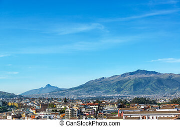Quito and Hills - View of Quito, Ecuador with large green...