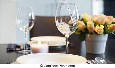 wine pouring into glasses - Simple home table setting, wine...