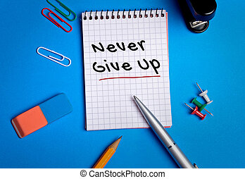 Never Give Up word on notebook page