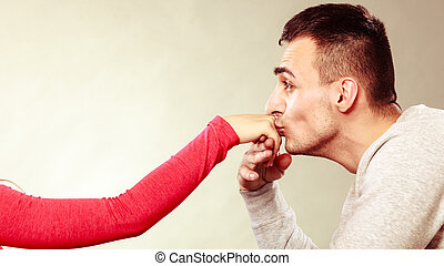 Man husband kissing woman hand. Love couple. - Polite man,...