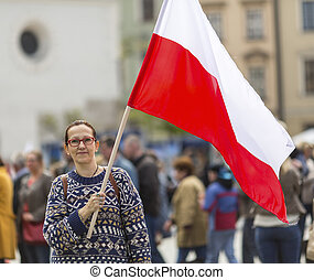 Young woman with the flag of Poland - Young woman on the...