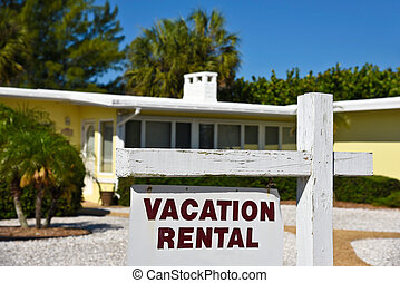 Vacation Rental House - A Vacation Rental Sign in front of a...