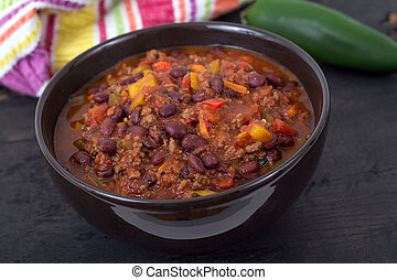 chili con carne beef chili on black table