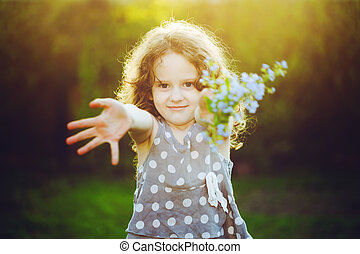 A little girl gives a bouquet to his mother or father Mum,...