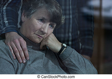 Senior woman with grandson - Senior sad woman is supported...